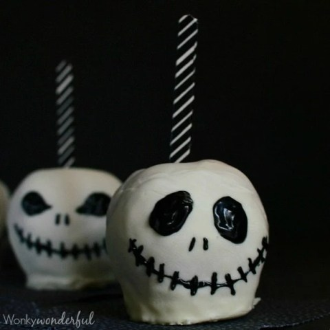 decorated white chocolate covered apples with black and white striped sticks