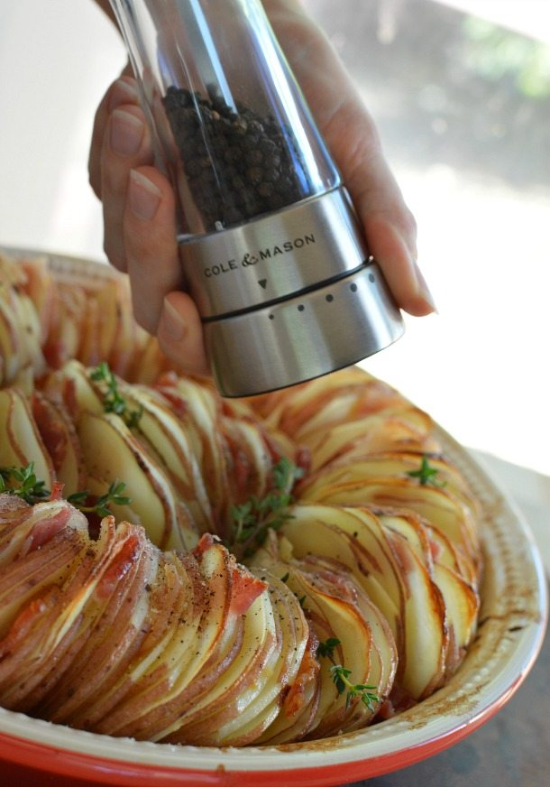 Roasted Potato Side Dish Recipe made with Roasted Garlic, Bacon, Thyme, Red Potatoes and fresh cracked Pepper.