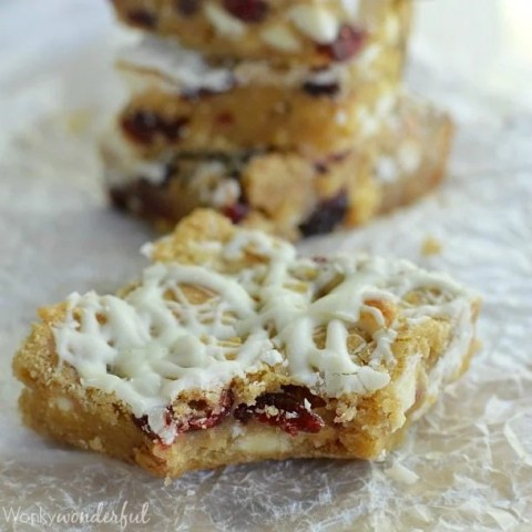 white chocolate cranberry bar with bite taken out