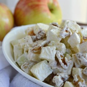 apple salad in white dish, apples in background