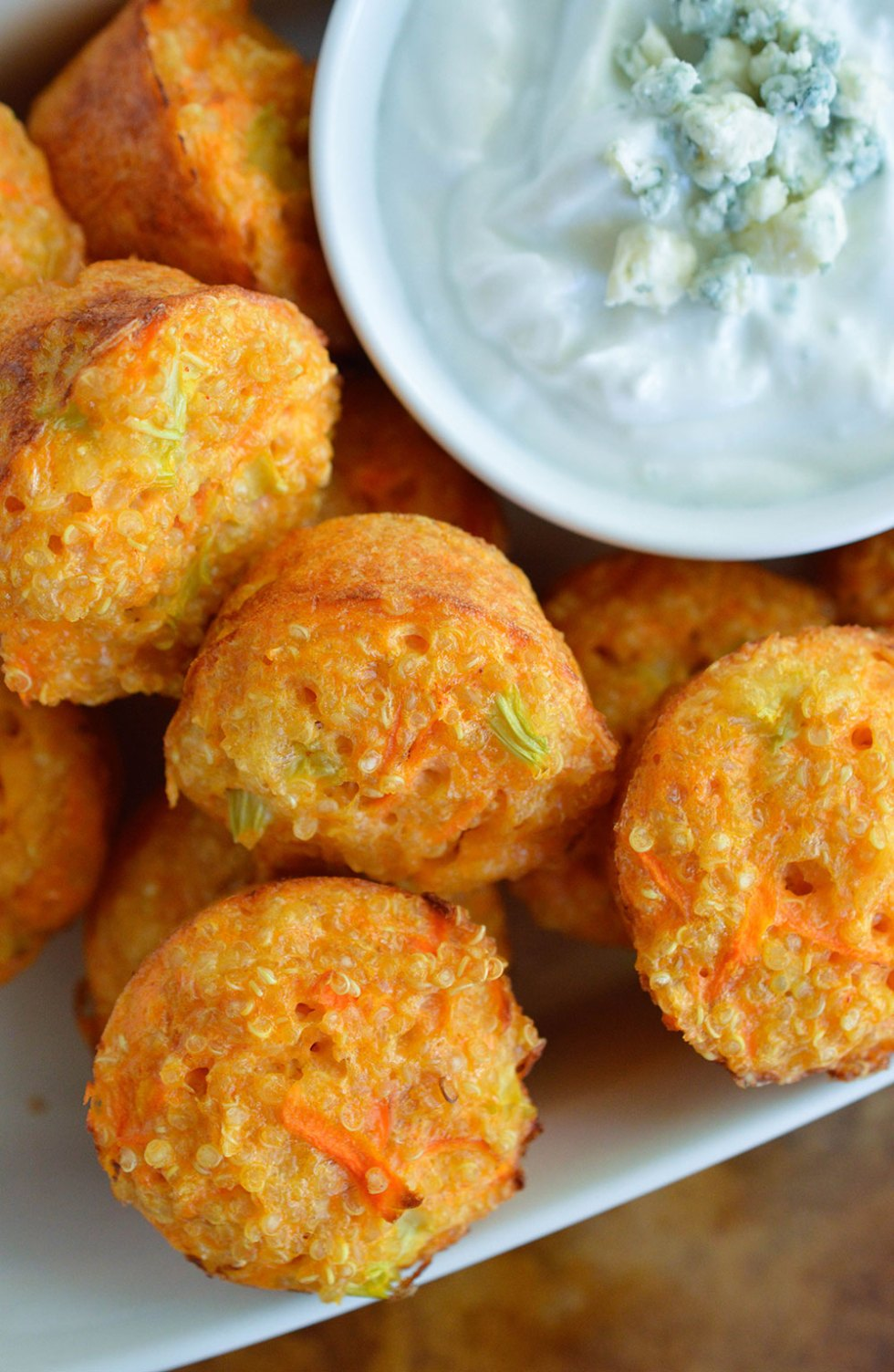 Quinoa Buffalo Bites have all the flavor of buffalo wings but are low fat and low calorie. This gluten free appetizer recipe is perfect for game day or parties! Baked quinoa bites with blue cheese Greek yogurt dipping sauce. #WeightWatchers