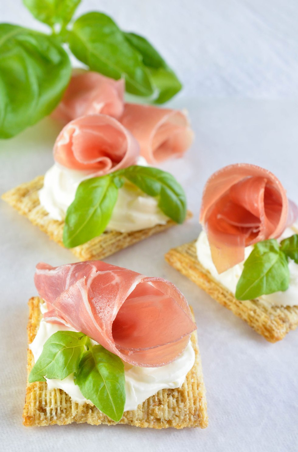 Easy Snack Recipe with Prosciutto, Basil and Mascarpone on Triscuit Crackers - This quick and simple appetizer or snack is impressive and delicious! With just 4 ingredients!