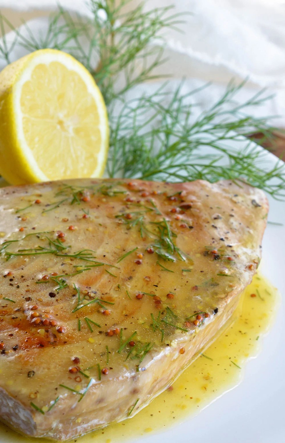 Pan Seared Tuna Steak with Lemon Dill Sauce makes a flavorful and healthy meal. This nutritious lunch or dinner is full of protein and ready in about 10 minutes!