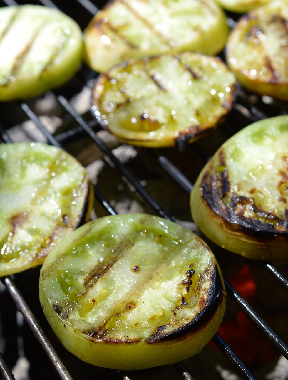 This Grilled Green Tomato Salsa Recipe is perfect for using up those green tomatoes! An easy green salsa verde with a smoky grilled flavor. The perfect summertime appetizer!