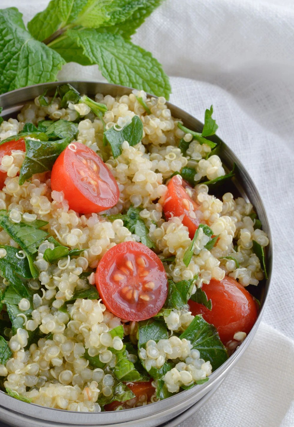 Quinoa Tabouleh Salad is a fresh and healthy lunch or dinner. Mint, parsley, tomatoes and lemon make this gluten free salad extra flavorful! This recipe is also known as tabbouleh or tabouli.