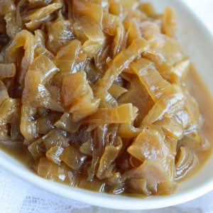 This Slow Cooker Caramelized Onions Recipe is the easy way to make sweet golden brown onions. Just load up your crockpot with onions, set it and forget it!