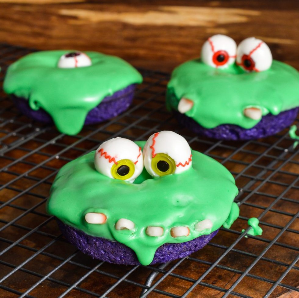Surprise the kids with this super fun and spooky treat! These Slime Monster Halloween Donuts are guaranteed to be a hit and make you The Cool Mom!