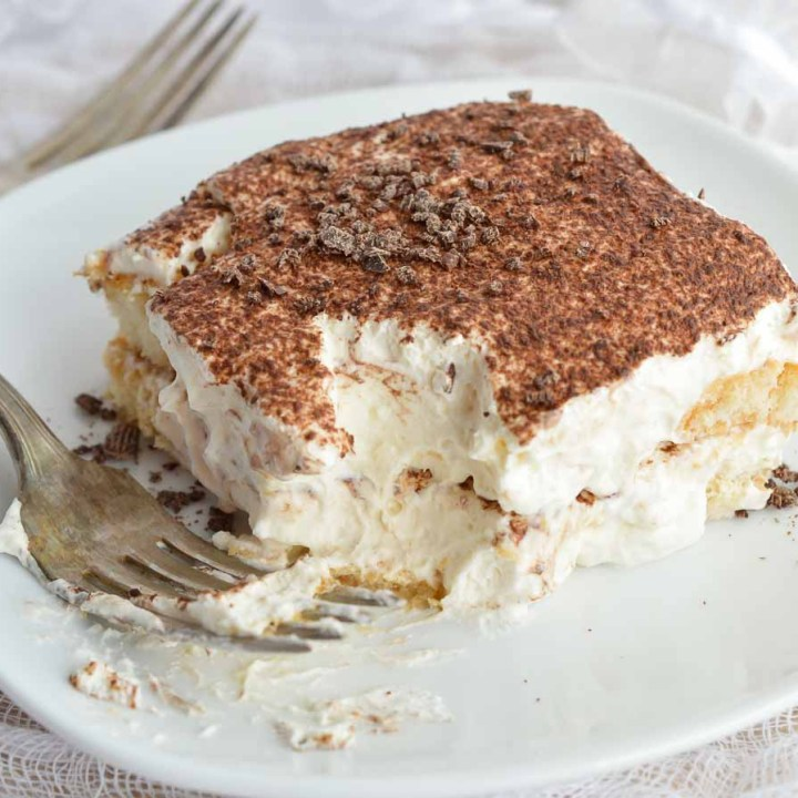 This Easy Tiramisu Recipe is perfect for any occasion! Ladyfingers soaked in Baileys and coffee then layered with mascarpone whipped cream. It will be your new favorite dessert!