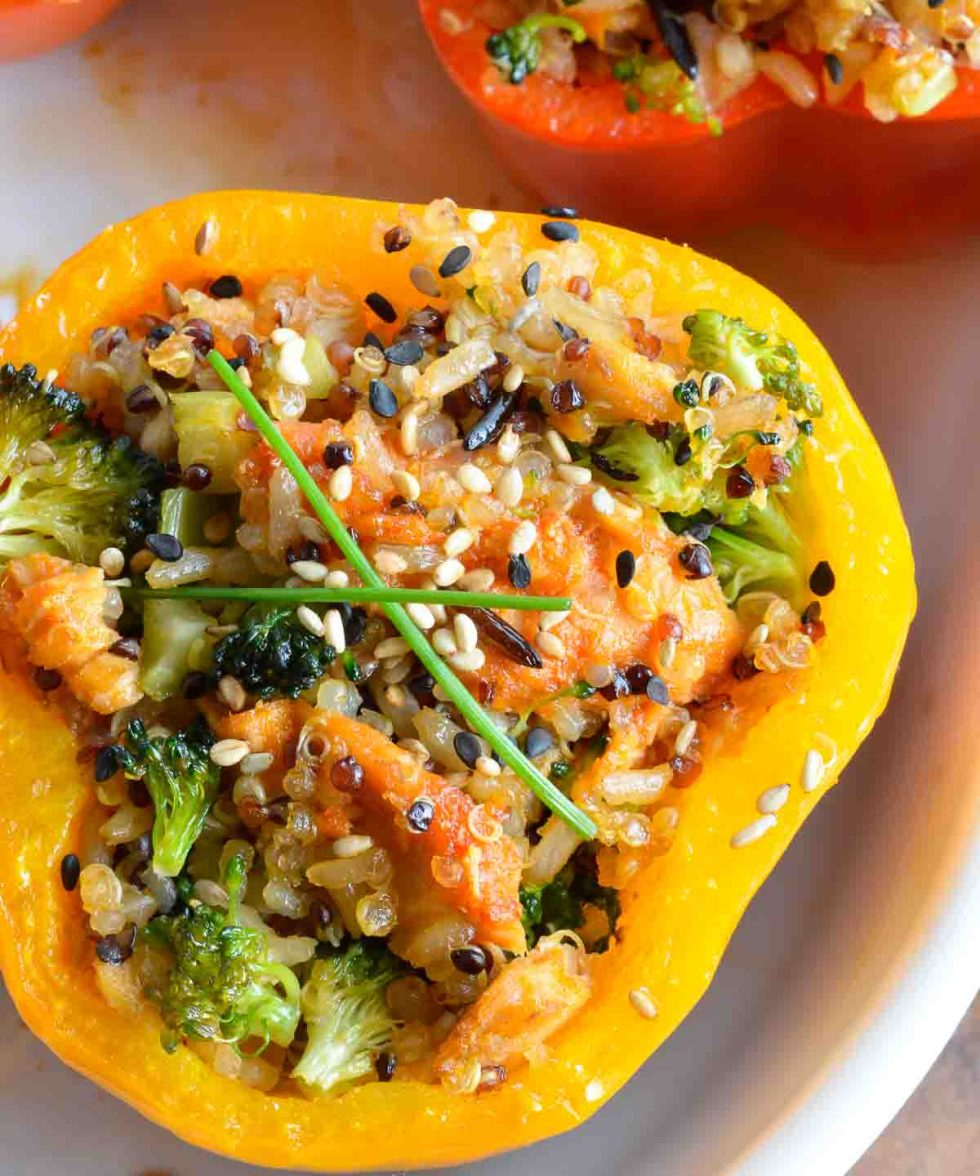This dinner recipe is healthy, flavorful and satisfying. Salmon and Quinoa Stuffed Peppers make a nutritious meal! Sweet bell peppers stuffed with salmon, brown rice, quinoa, broccoli and a spicy Asian sauce.