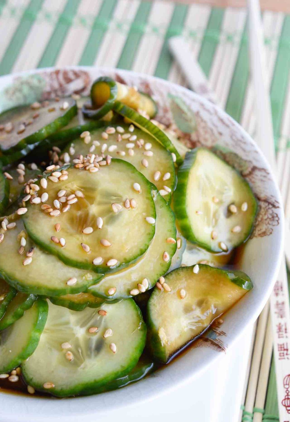 This Cucumber Salad Recipe is a quick, easy side dish that is perfect for summer! Thinly sliced cucumbers in a soy sauce sesame seed dressing. A cool vegan cucumber salad with Asian flair!