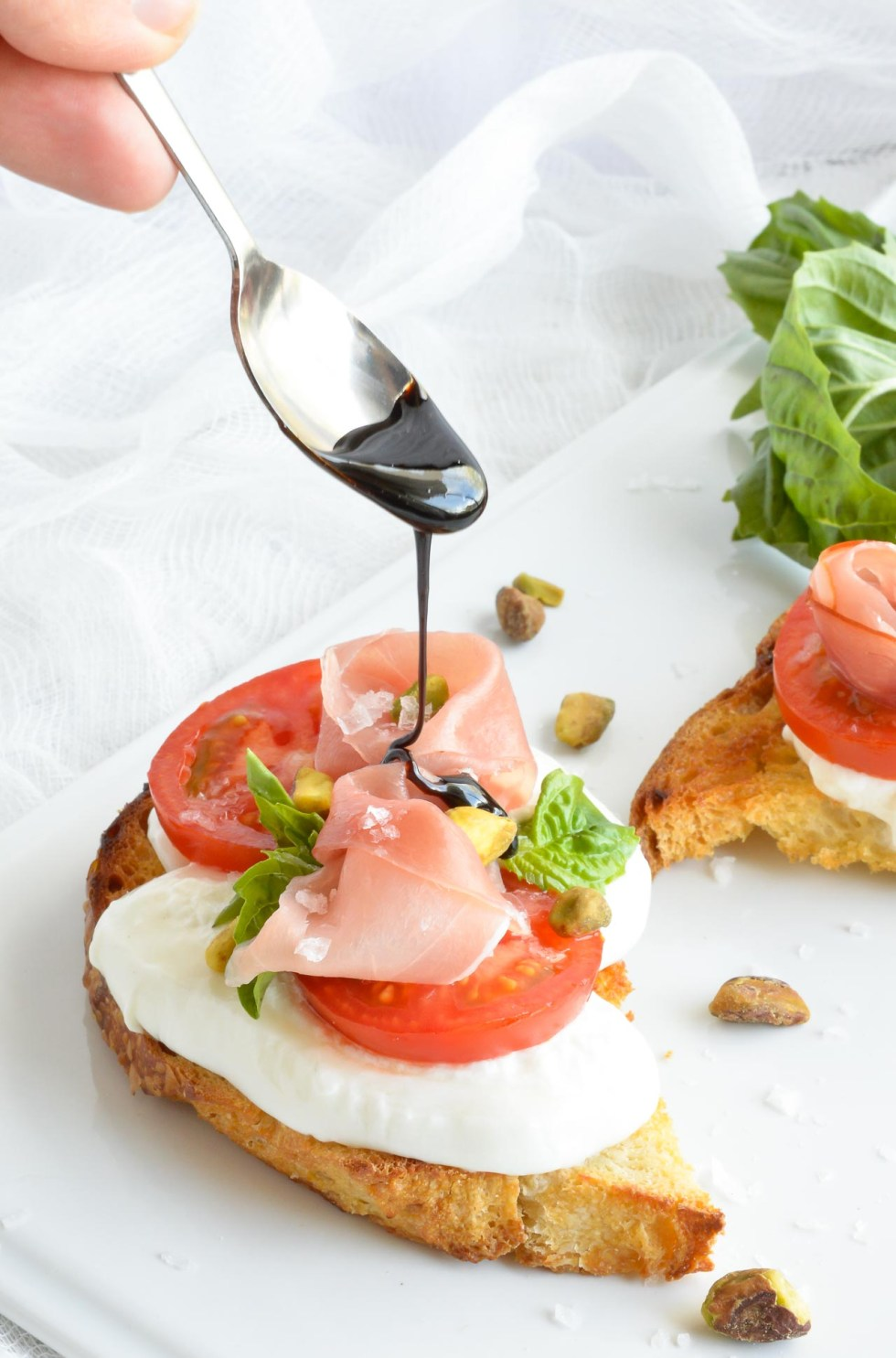 Sometimes you just need to indulge in the finer things in life. I'm showing you How To Make Balsamic Glaze for the Ultimate Sandwich. The most amazing ingredients come together in this simple yet fancy recipe. Sliced sourdough, prosciutto, burrata cheese, fresh tomatoes, basil, pistachios and balsamic vinegar glaze. Treat Yourself!