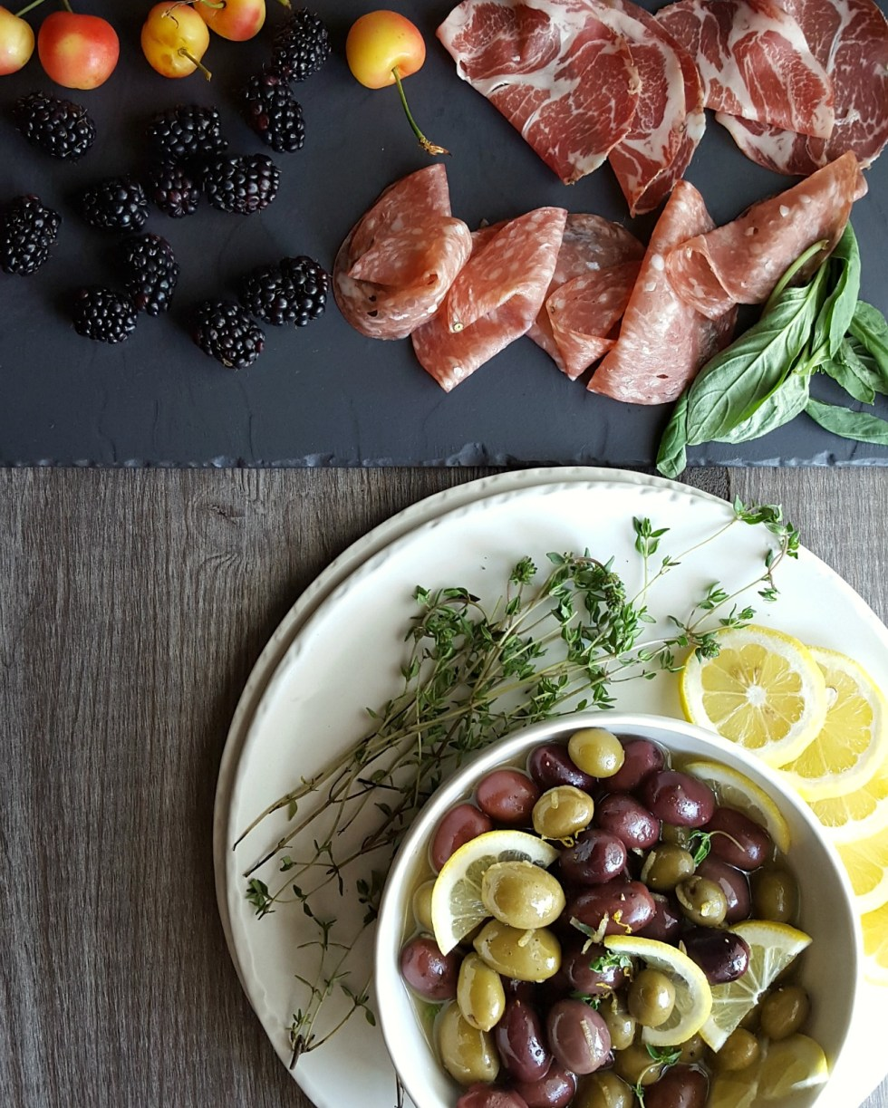 Lemon Thyme Marinated Olives are so simple and easy to make. This appetizer recipe takes about 5 minutes to make and is perfect for parties or wine tasting!