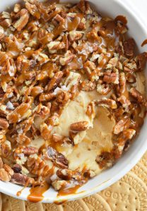 If you need a last minute dessert recipe that is sure to be a hit this Caramel Pecan Cheesecake Dip is it! Caramel marshmallow fluff cream cheese filling is topped with pecans, caramel and flaked salt. This dessert dip is so tasty and only takes 5 minutes to make!