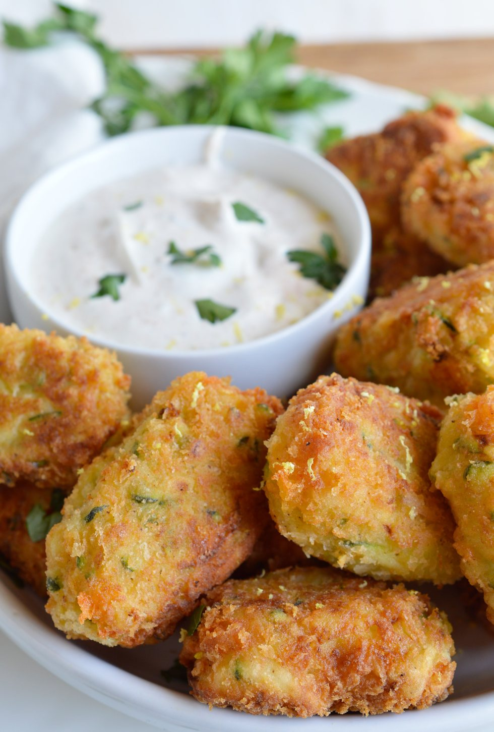 With the end of summer comes an abundance of fresh zucchini. Try this Cheesy Zucchini Tater Tots Recipe and that zucchini will be gone in no time! Cheese, zucchini and potatoes fried up into homemade tater tots. vegetarian