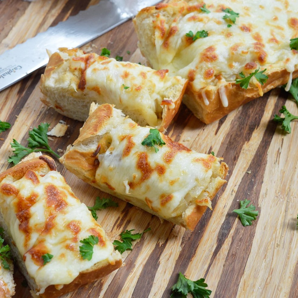 It doesn't get easier than this Cheesy Onion Bread recipe. French bread topped with sweet onions sautéed to golden perfection and mozzarella cheese makes a great appetizer or side dish.
