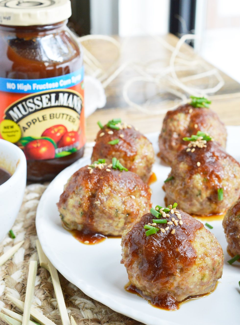 These Saucy Asian Meatballs are perfect for parties! This easy appetizer recipe is a combo of baked meatballs and a sweet ginger sauce that takes just 10 minutes to make.