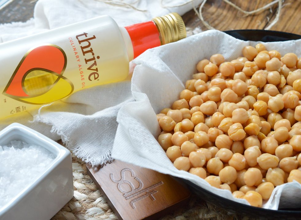 If you're looking for a healthy snack to satisfy that salty, crunchy craving, these Crispy Roasted Chickpeas are it! Learn how to toast chickpeas in the oven making them a nutritious high protein snack recipe.