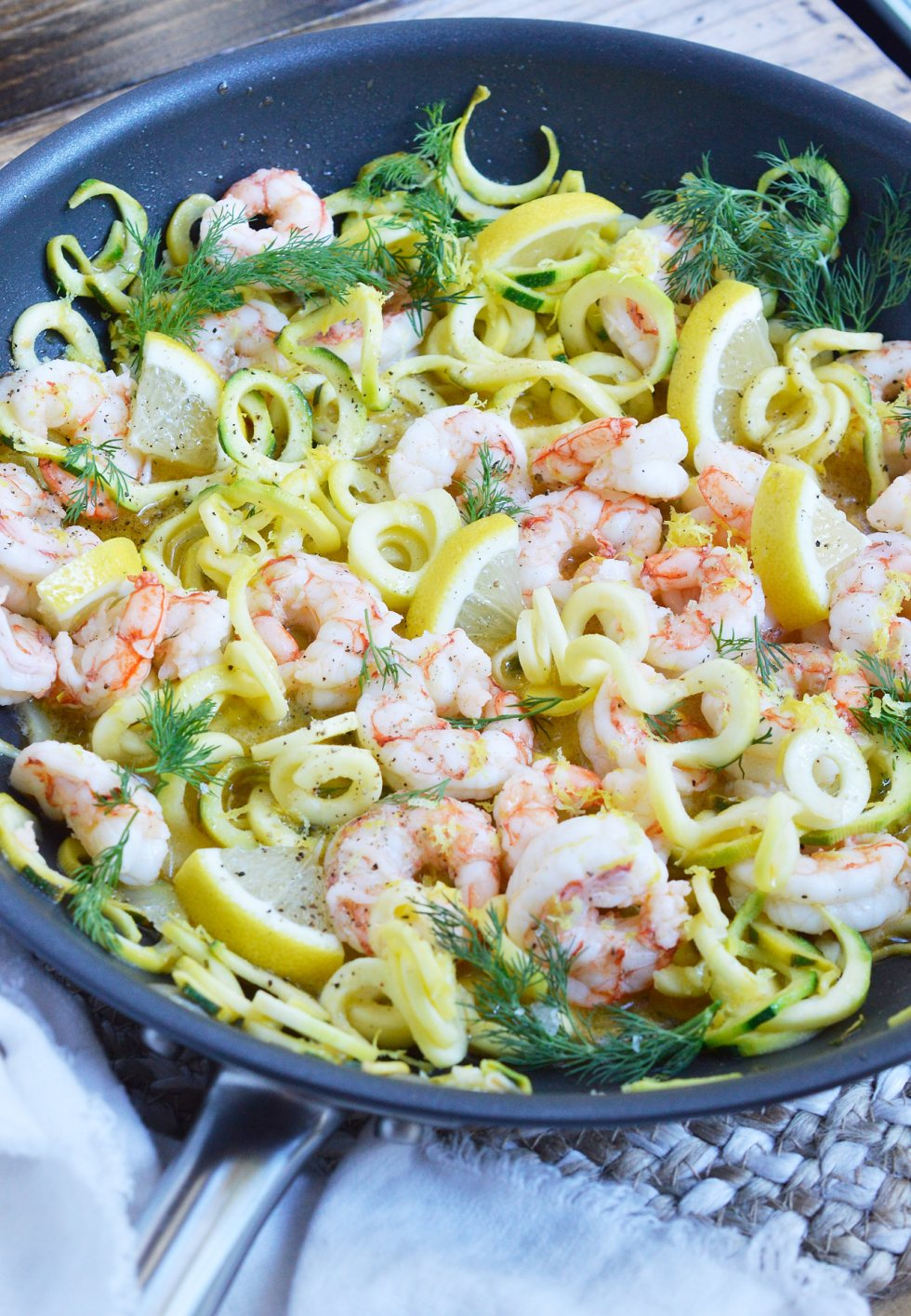 This Lemon Dill Shrimp Zucchini Noodle Recipe is a great way to start the New Year! A great lunch or dinner that is healthy, filling and Whole30 compliant. Shrimp and zoodles tossed with a lemon dill sauce makes a flavorful, nutritious meal!