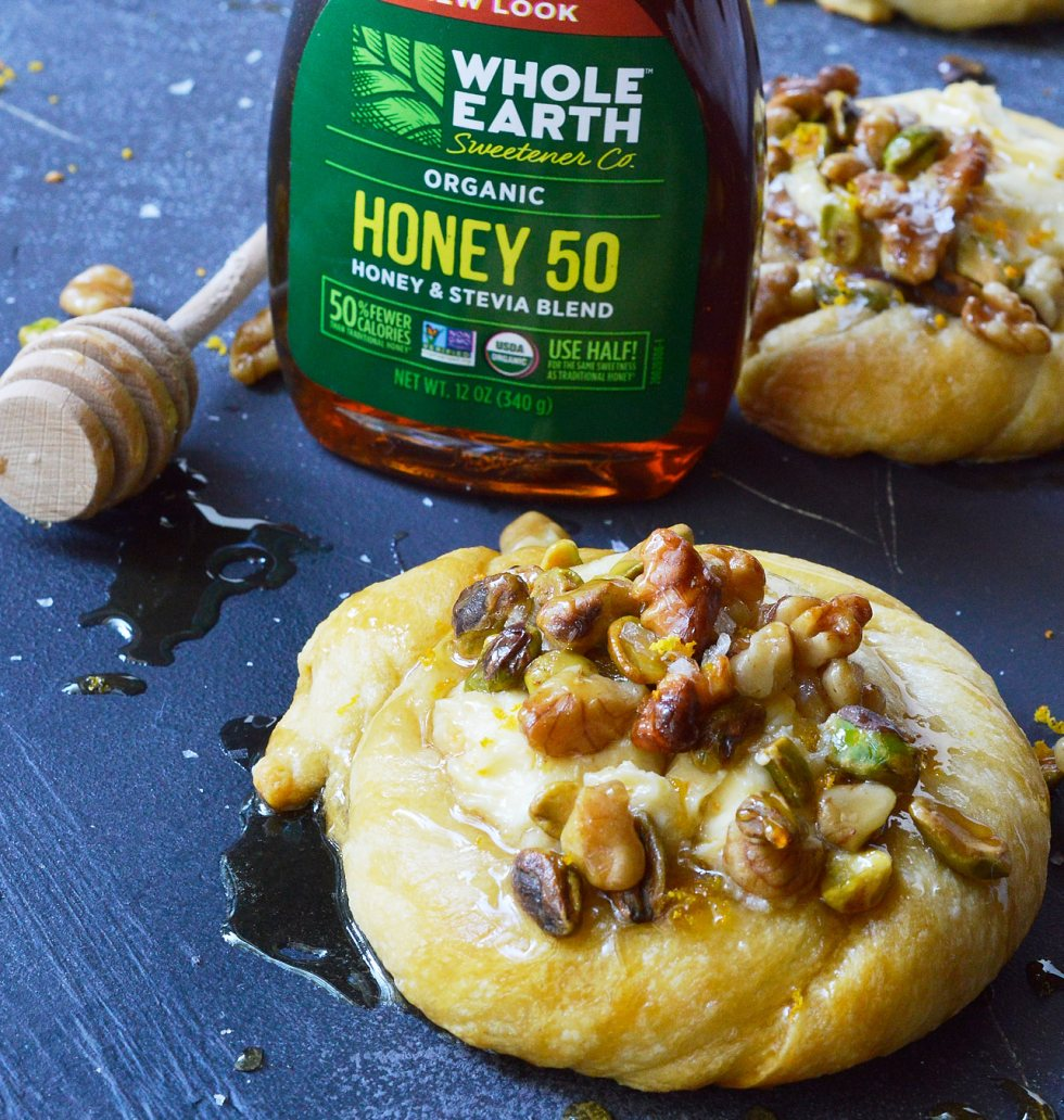 Do you want to make an amazing breakfast pastry without all the fuss? This Honey Nut Cream Cheese Danish Recipe is unbelievably simple. Use crescent rolls as a shortcut then fill with orange infused cream cheese, top with honeyed walnuts and pistachios.