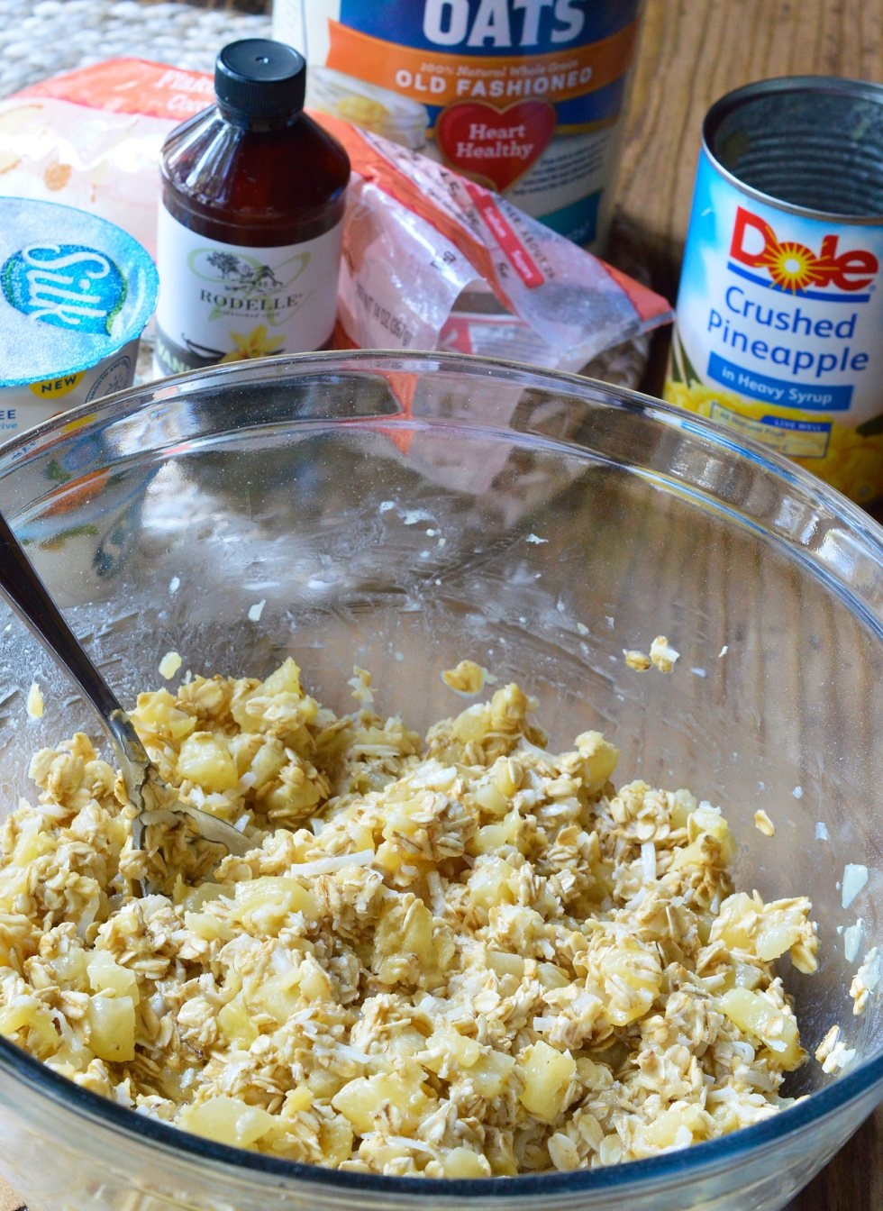 If you want a sweet and satisfying breakfast, this Pineapple Coconut Dairy Free Baked Oatmeal Recipe is perfect! This super simple recipe is a great way to liven up your morning oatmeal. Oatmeal, pineapple and coconut are baked and served like cake with a dollop of vanilla yogurt and a generous drizzle of maple syrup. This gluten free, vegetarian, dairy free breakfast will be a hit!