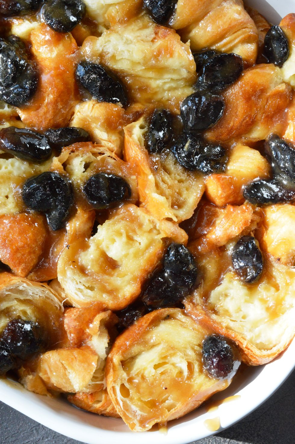 Go ahead and indulge your sweet craving with this Rum Raisin Croissant Bread Pudding Bake Recipe. Perfect for a dessert to feed a crowd or as an easy breakfast casserole. Made with buttermilk, croissants, royal raisins and rum flavor!