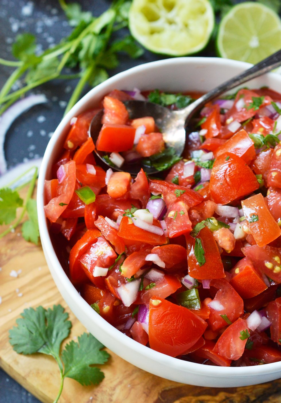 Start the summer off right with Fresh Homemade Pico de Gallo that is spiked with Tequila. Perfect for a party appetizer or a tasty snack by the pool! This salsa is great with chips or use it as a fresh, flavorful condiment. Omit the tequila and this recipe is Paleo & Whole30 friendly, grain free, gluten free, vegan, vegetarian and dairy free. #dairyfreerecipes #picodegallo #salsarecipes #paleohacks