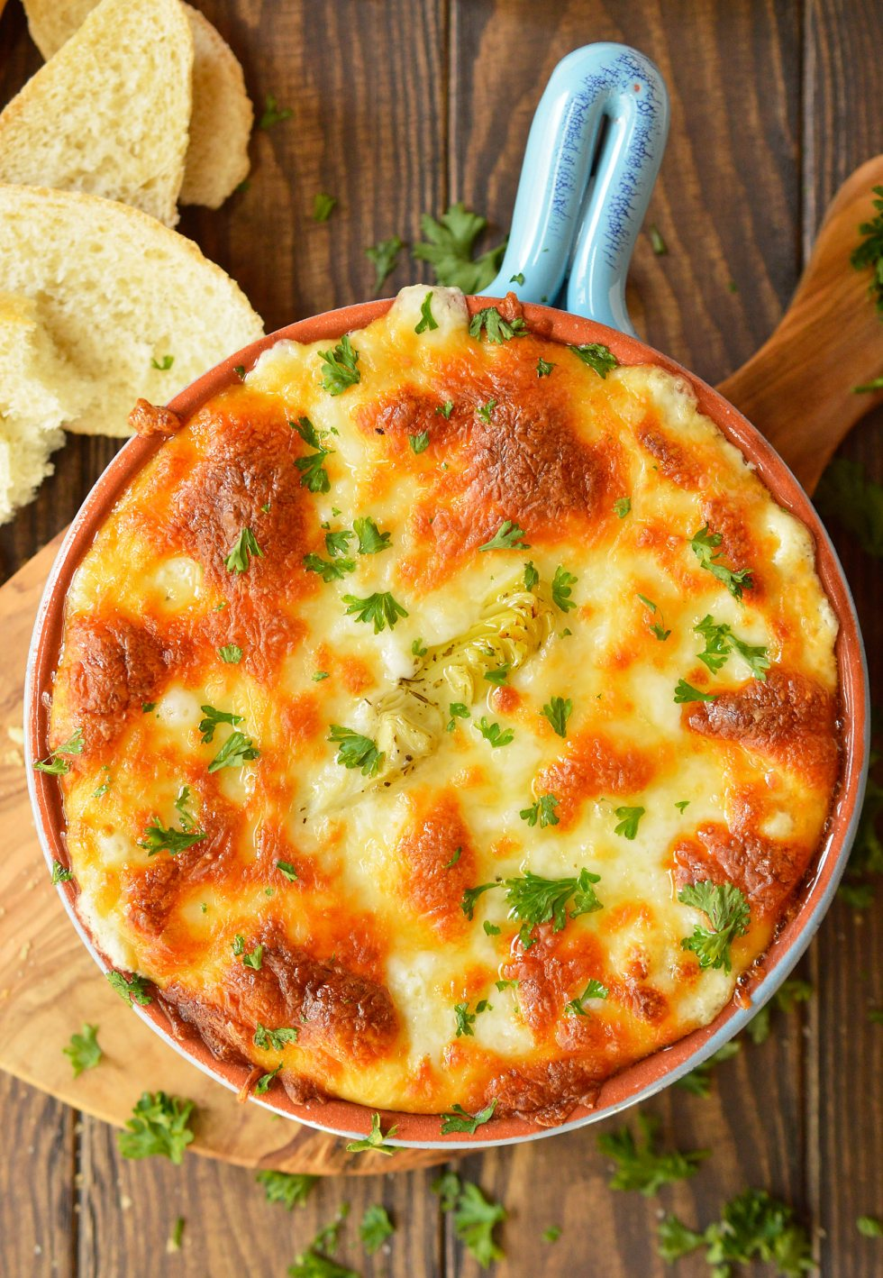Looking for a cheesy appetizer to feed your hungry crowd? ThisHot Green Chile Artichoke Dip Recipe takes a family favorite to the next level with a punch of green chile flavor! This recipe is quick, easy and perfect for game day or holiday feasts. #appetizer