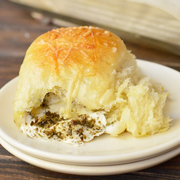 cheese stuffed roll on white plate