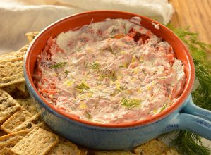 This Smoked Salmon Dip is one of my family's favorite holiday appetizer recipes. Every year I make this creamy dip full of smoked salmon, dill and lemon. An easy 5 minute appetizer that is sure to be a hit!