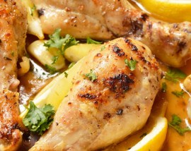 buttery lemon garlic chicken drumsticks in roasting pan
