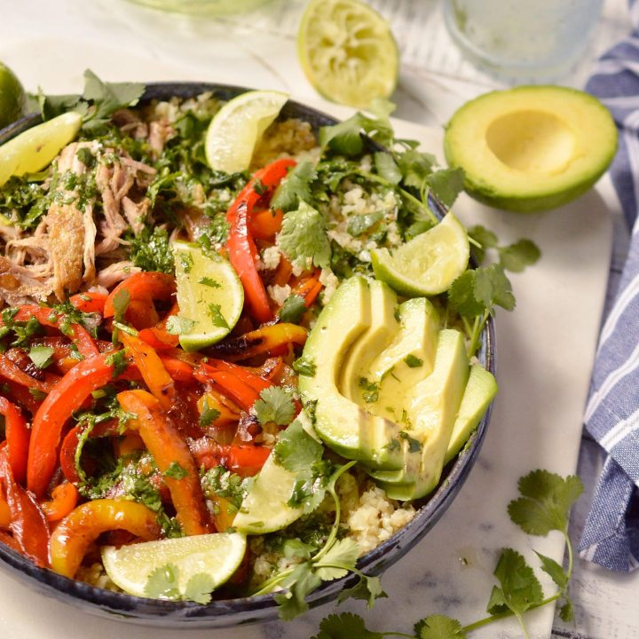 peppers, avocado, pork and limes in blue serving bowl