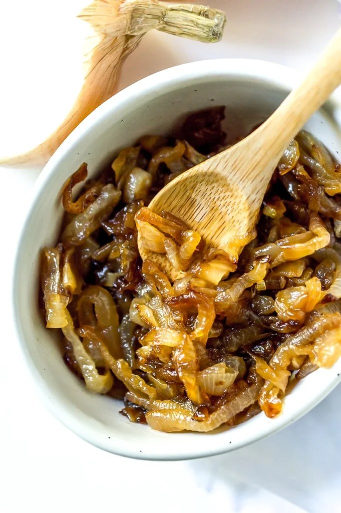 white bowl filled with golden brown caramelized onions