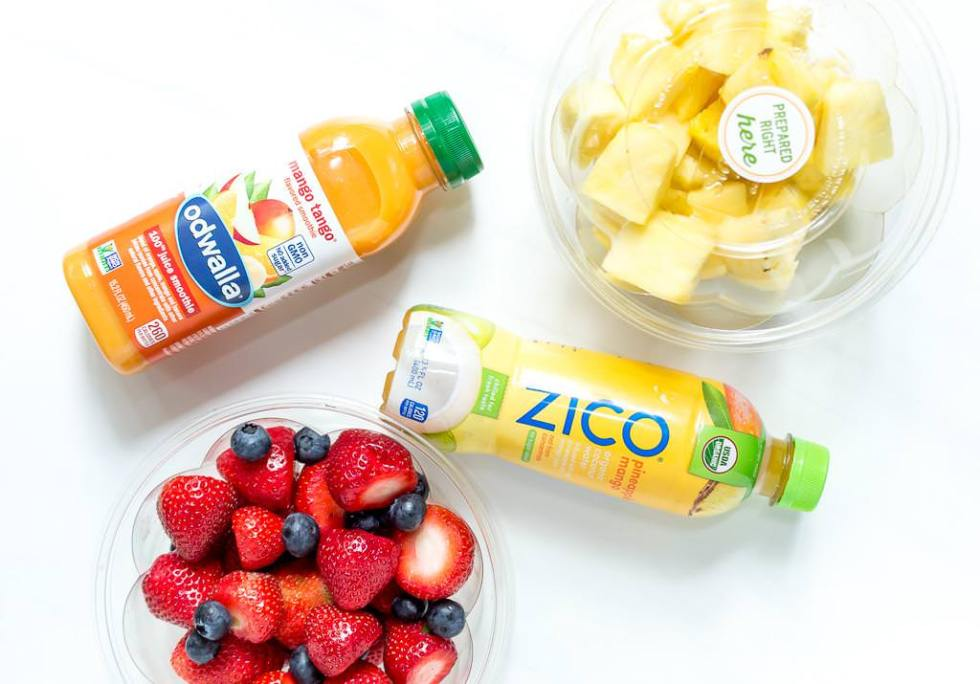 zico and odwalla beverages alongside safeway precut fruit packages