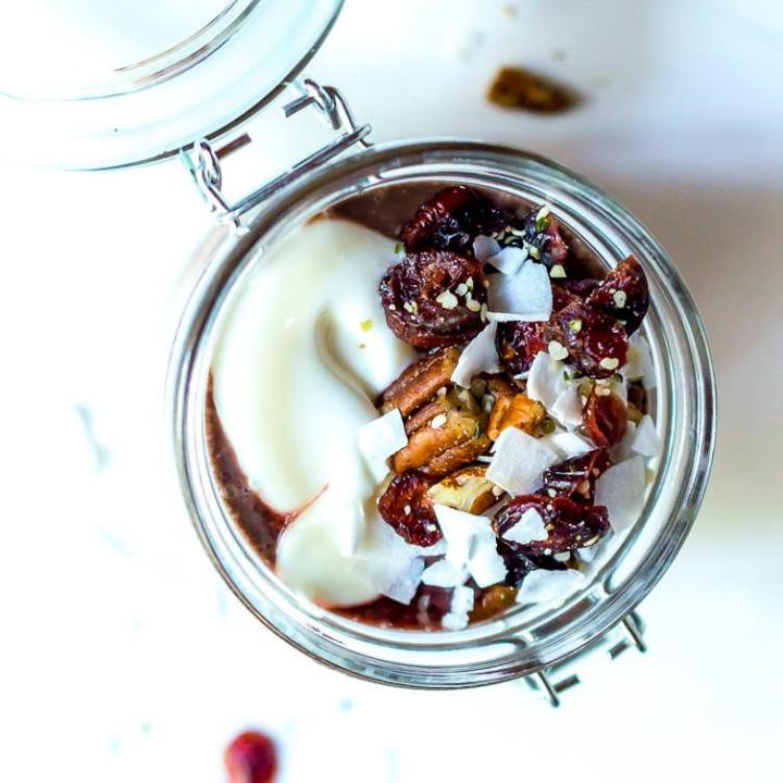 overhead view of acai yogurt parfait with nuts and coconut on top
