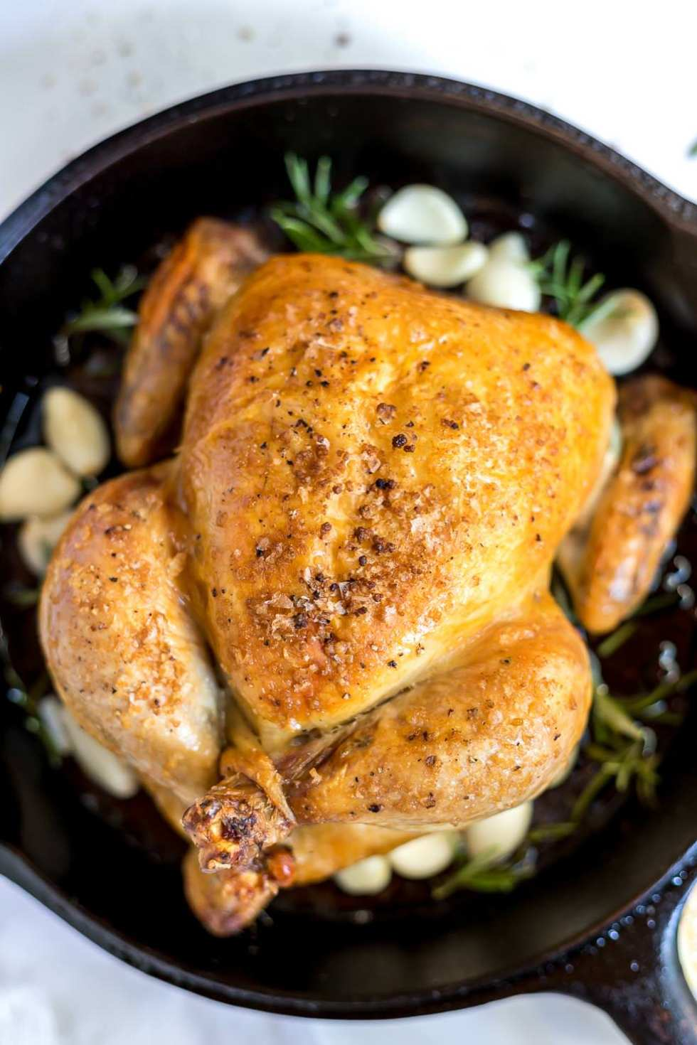 perfectly golden roast chicken in cast iron skillet