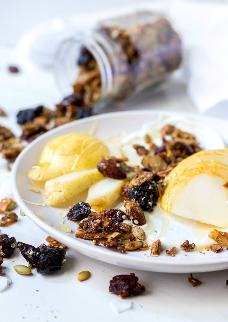 sliced pears and yogurt topped with paleo granola