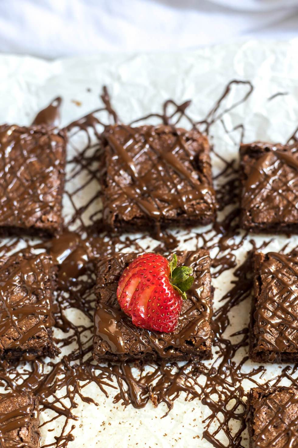 gluten free brownies with chocolate drizzle and strawberries