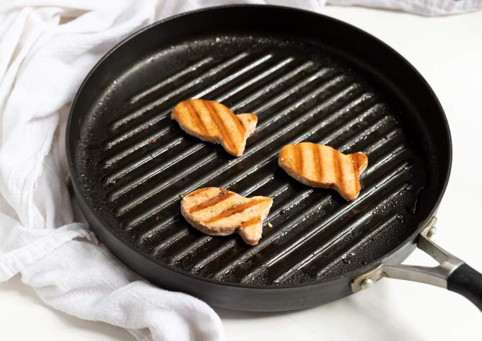 Happy Fish salmon patties in black grill pan