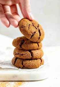 hand grabbing a ginger cookie