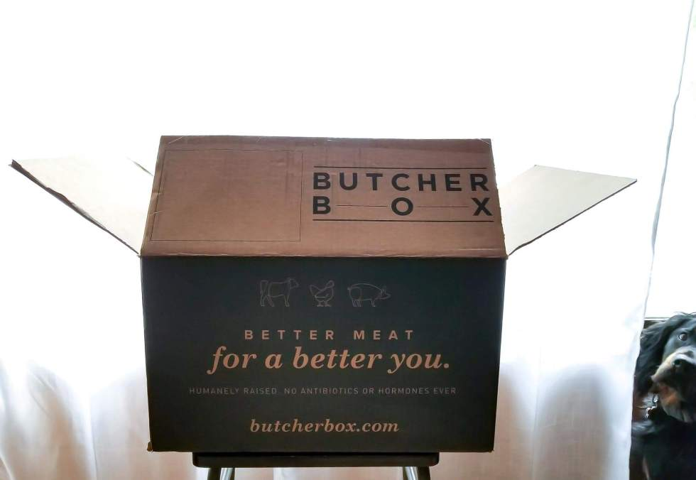 butcher box package with dog photobombing on the side