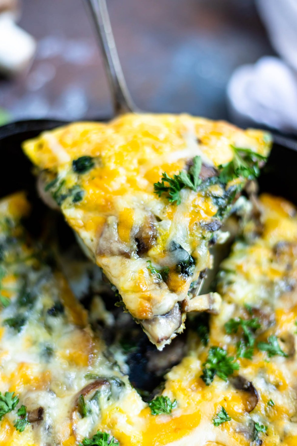 slice of mushroom spinach frittata being served