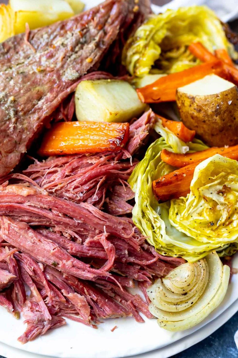 shredded corned beef recipe served on white platter with roasted vegetables