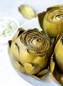 pressure cooker artichoke served on white plate