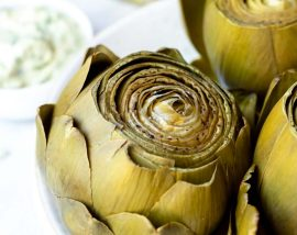 pressure cooker artichoke served on white plate