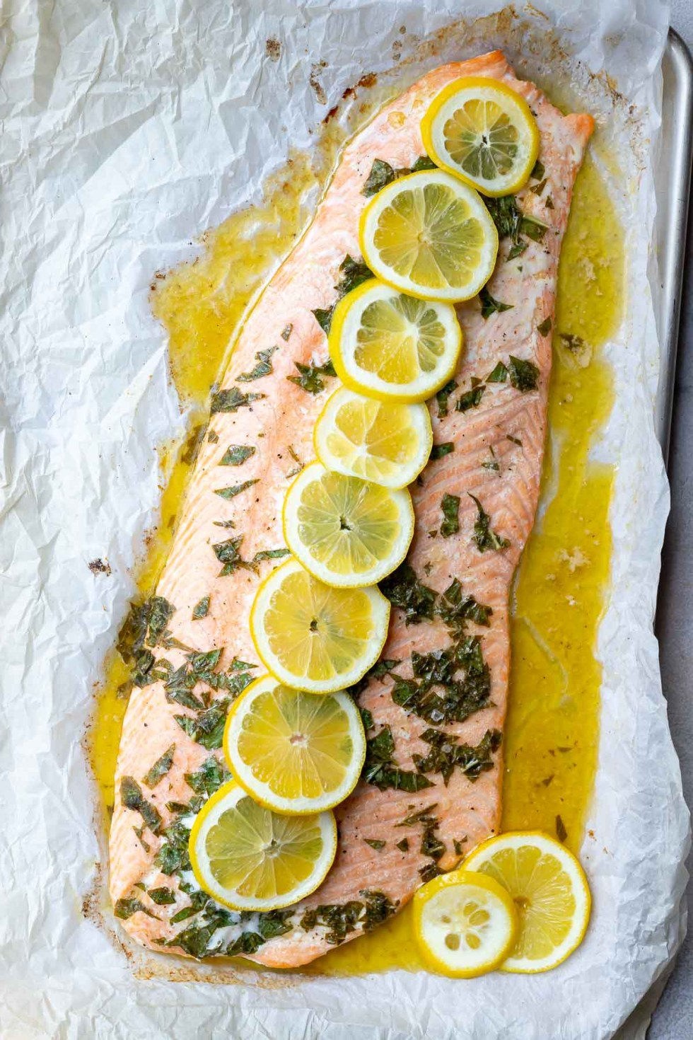 lemon basil salmon on baking sheet lined with parchment paper