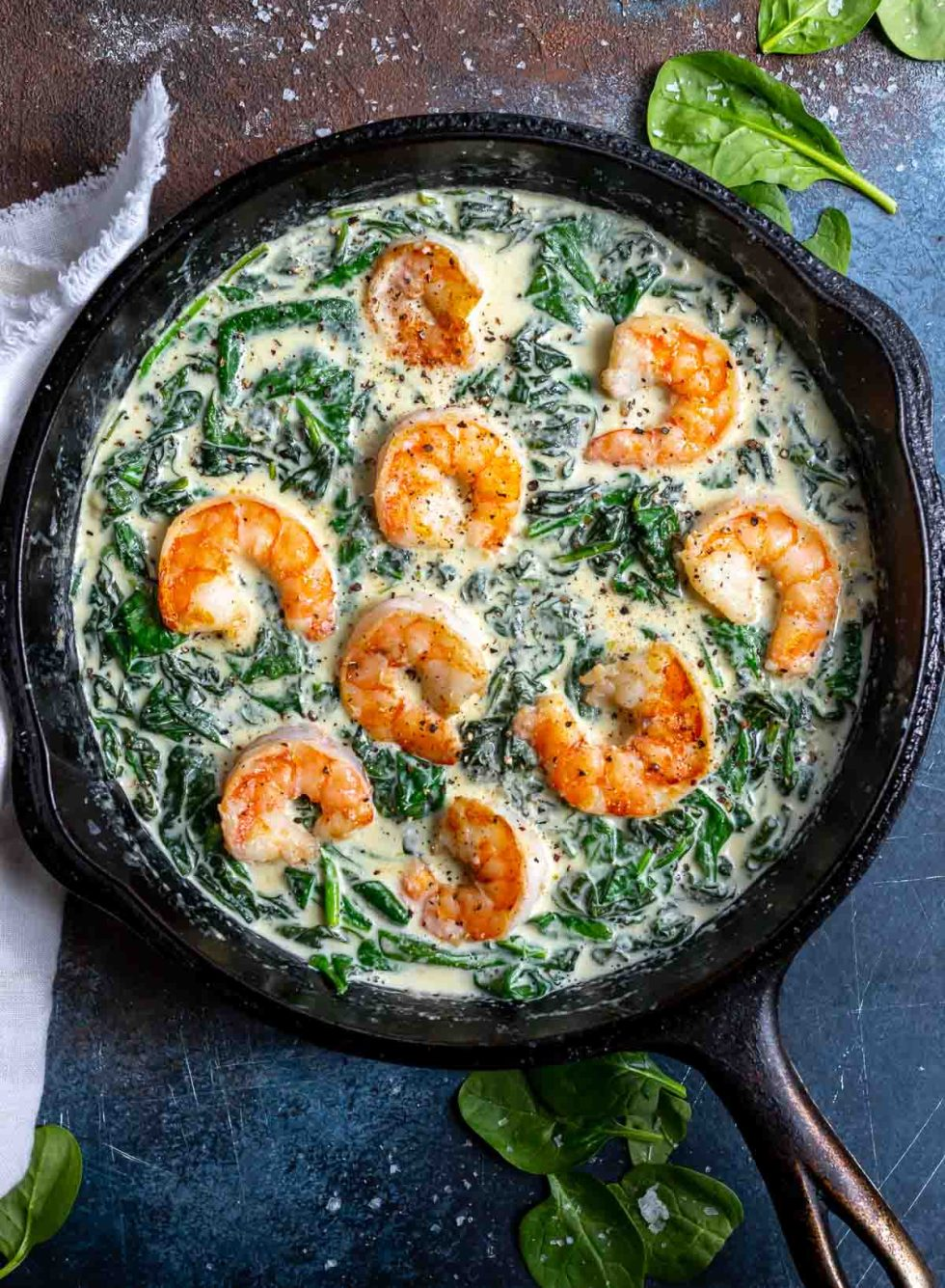 creamed spinach and shrimp in cast iron pan