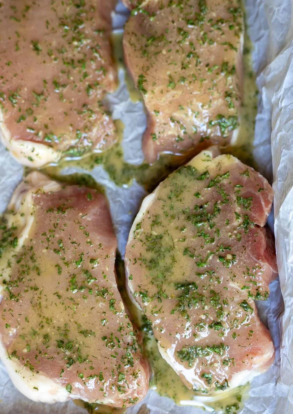 raw pork chops coated with seasoning