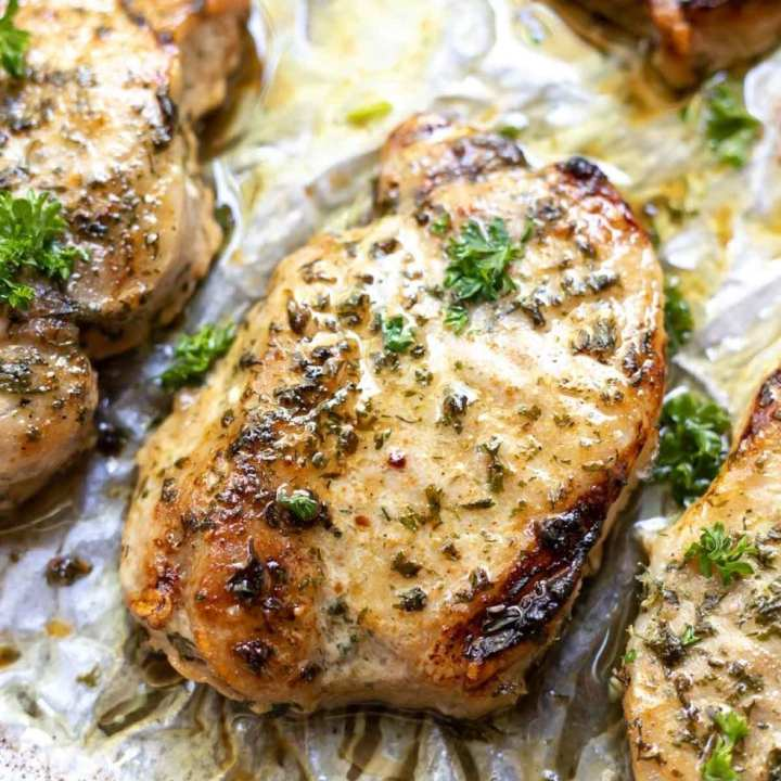 pork chops on baking sheet