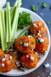 chicken meatballs with buffalo sauce and blue cheese in white bowl