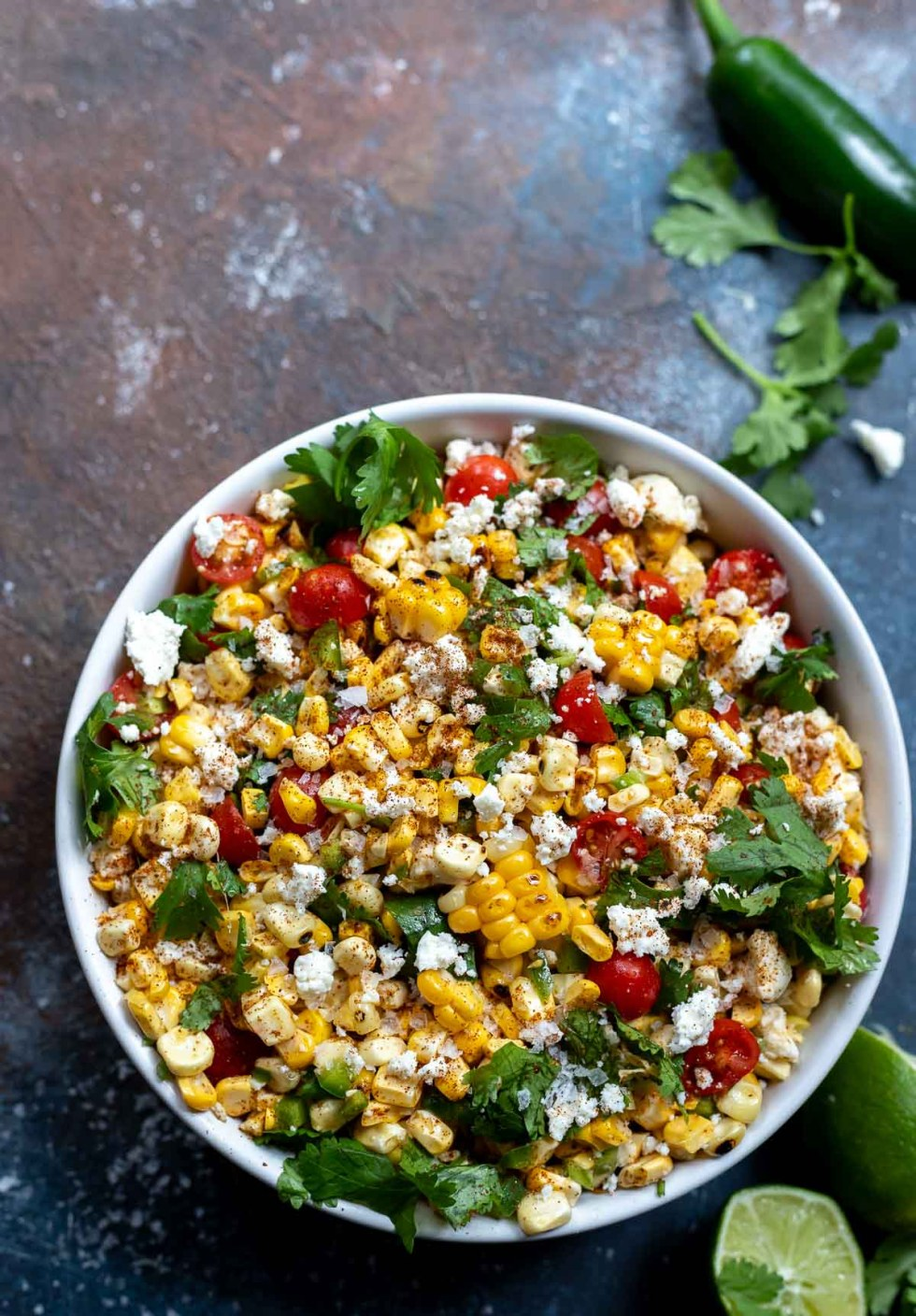 white bowl filled with roasted corn salad